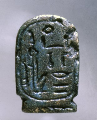 Amulet in the Form of a Cartouche Hatshepsut. Faience, glazed, 1 1/8 x 11/16 x 1/4 in. (2.8 x 1.8 x 0.6 cm). Brooklyn Museum, Charles Edwin Wilbour Fund, 37.1216E. Creative Commons-BY