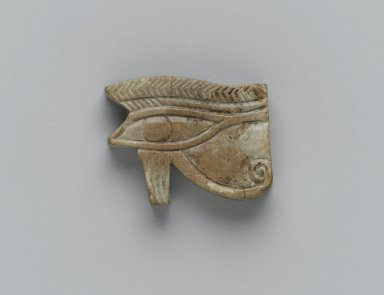 Egyptian. Wadjet-eye Amulet, 664-30 B.C.E. Faience, glazed, 7/8 x 1/4 x 1 1/8 in. (2.2 x 0.6 x 2.8 cm). Brooklyn Museum, Charles Edwin Wilbour Fund, 37.1294E. Creative Commons-BY