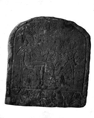 Upper Part of Funerary Stela. Limestone, gessoed or plastered, 13 x 11 13/16 x 3 15/16 in. (33 x 30 x 10 cm). Brooklyn Museum, Charles Edwin Wilbour Fund, 37.1350E. Creative Commons-BY