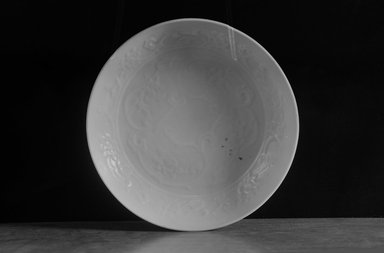 Plate, 1279-1368. Porcelain with egg white (luanbai) glaze, 1 3/4 x 6 5/8 in. (4.5 x 16.8 cm). Brooklyn Museum, By exchange, 37.135. Creative Commons-BY
