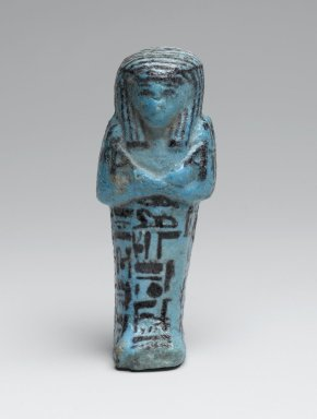 Small Shabty of the Chief Draftsman Amen-em-opet, ca. 1075-656 B.C.E. Faience, 4 1/8 x 1 9/16 x 1 7/16 in. (10.5 x 4 x 3.6 cm). Brooklyn Museum, Charles Edwin Wilbour Fund, 37.138E. Creative Commons-BY