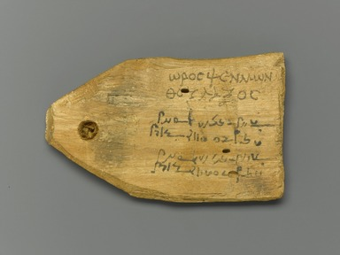 Tag for Mummy of a Stonecutter, with Text in Greek and Demotic, 30 B.C.E.-365 C.E. Wood, ink, 2 7/16 x 4 x 1/2 in. (6.2 x 10.2 x 1.2 cm). Brooklyn Museum, Charles Edwin Wilbour Fund, 37.1395E. Creative Commons-BY