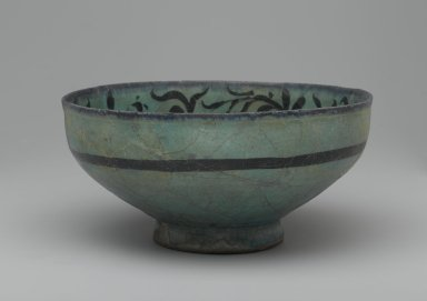 Bowl with Water-Weed Motif, early 13th century. Ceramic; fritware, painted in black under a transparent turquoise glaze, 3 3/4 x 7 11/16 in. (9.5 x 19.5 cm). Brooklyn Museum, Designated Purchase Fund, 37.147. Creative Commons-BY