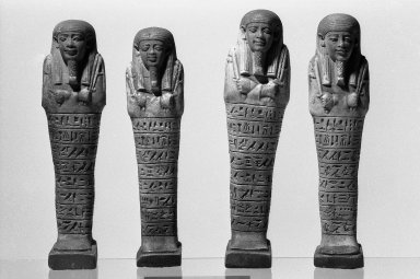 Ushabti of Psamtek, 664-525 B.C.E. Faience, 7 5/16 x 1 7/8 x 1 1/8 in. (18.6 x 4.7 x 2.9 cm). Brooklyn Museum, Charles Edwin Wilbour Fund, 37.163E. Creative Commons-BY