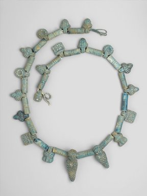 Necklace from a Statue, 664-332 B.C.E. Faience, glazed, 1 5/8 x 52 in. length (4.2 x 132.1 cm). Brooklyn Museum, Charles Edwin Wilbour Fund, 37.1824E.1-.43. Creative Commons-BY