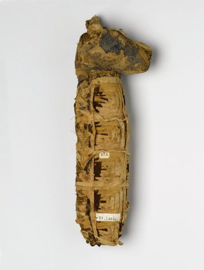 Dog Mummy, 510-230 B.C.E. Animal remains, linen, 3 1/4 x 17 x 5 1/2 in. (8.3 x 43.2 x 14 cm). Brooklyn Museum, Charles Edwin Wilbour Fund, 37.1984E. Creative Commons-BY