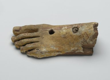 Left Foot from an Anthropoid Coffin, 30 B.C. - 2nd century C.E. Wood, plaster, 2 1/16 x 3 1/5 x 6 5/8 in. (5.2 x 7.7 x 16.8 cm). Brooklyn Museum, Charles Edwin Wilbour Fund, 37.2041.1E. Creative Commons-BY