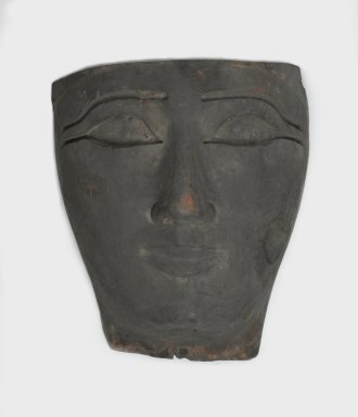 Face from an Anthropoid Coffin, 1075-656 B.C. Wood, 14 2/5 x 6 3/10 x 10 7/10 in. (36.6 x 16 x 27.2 cm). Brooklyn Museum, Charles Edwin Wilbour Fund, 37.2041.8E. Creative Commons-BY