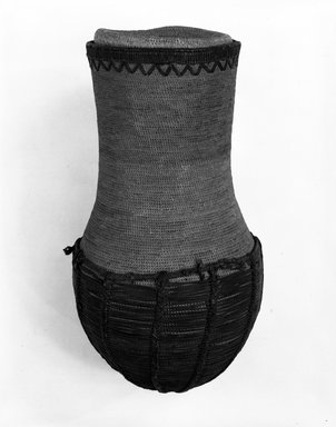 Basket and Top, early 20th century. Vegetable fiber, leather, height: 16 in. Brooklyn Museum, Gift of Mrs. Frederic B. Pratt, 37.206a-b. Creative Commons-BY