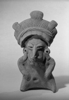 Female Figurine. Ceramic, 4 1/4 x 2 1/2 x 7 3/4 in. (10.8 x 6.4 x 19.7 cm). Brooklyn Museum, 37.256. Creative Commons-BY
