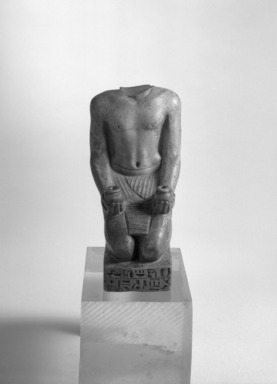 Kneeling Statue of Nesbanebdjedet, ca. 755-730 B.C.E. Steatite or faience, glazed, 5 3/8 x 1 7/8 x 3 1/4 in. (13.6 x 4.8 x 8.3 cm). Brooklyn Museum, Charles Edwin Wilbour Fund, 37.344E. Creative Commons-BY