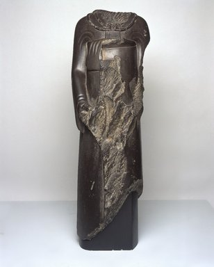 Overseer of the Treasury Ptahhotep in Persian Costume, 525-490 B.C.E. Schist, 32 11/16 x 10 5/8 in. (83 x 27 cm). Brooklyn Museum, Charles Edwin Wilbour Fund, 37.353. Creative Commons-BY