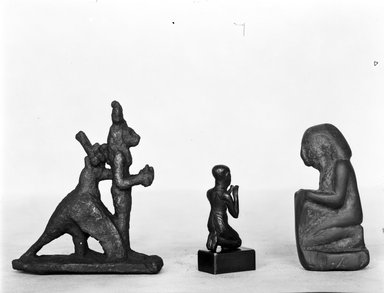 Group of the Goddess Sekhmet Standing Surmounted by the Sun Disk within the Embrace of a Jackal - Headed Bird. Bronze, 3 7/16 x 1 1/16 x 3 1/16 in. (8.8 x 2.7 x 7.7 cm). Brooklyn Museum, Charles Edwin Wilbour Fund, 37.689E. Creative Commons-BY