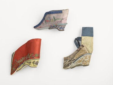 Pair of Shoes for Woman's Bound Feet, 19th century. Wood, embroidered satin silk, cloth silk, leather, Each: 5 1/8 x 4 5/16 in. (13 x 11 cm). Brooklyn Museum, Brooklyn Museum Collection, 34.1496. Creative Commons-BY