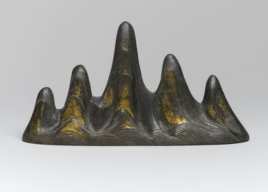 Brush Rest in the Form of a Mountain, 18th century (possibly). Bronze, traces of gilding, 3 7/8 x 1 11/16 x 7 1/16 in. (9.8 x 4.3 x 17.9 cm). Brooklyn Museum, Frank L. Babbott Fund, 37.371.13. Creative Commons-BY