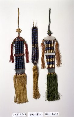 Incense Bead Tassel (Norigae), 20th century. Beads, kingfisher feathers, silk, Overall length: 17 11/16 in. (45 cm). Brooklyn Museum, Frank L. Babbott Fund, 37.371.243. Creative Commons-BY