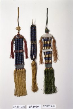 Incense Bead Tassel (Norigae), 20th century. Gold, nephrite, kingfisher feathers, silk, Overall length: 15 in. (38.1 cm). Brooklyn Museum, Frank L. Babbott Fund, 37.371.246. Creative Commons-BY