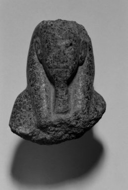 Fragmentary Shabti of Akhenaten, ca. 1352-1336 B.C.E. Black granite, 3 9/16 x  width at base 2 11/16 in. (9 x 6.8 cm). Brooklyn Museum, Charles Edwin Wilbour Fund, 37.508. Creative Commons-BY