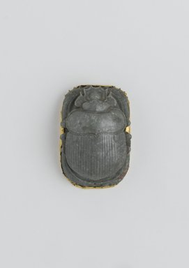 Heart Scarab, 664-525 B.C.E. Steatite and sheet gold, 7/8 x 1 7/16 x 2 1/16 in. (2.3 x 3.6 x 5.3 cm). Brooklyn Museum, Charles Edwin Wilbour Fund, 37.717E. Creative Commons-BY
