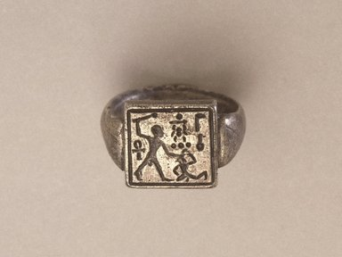 Signet Ring Bearing the Name of Amunhotep II, 1450-1425 B.C.E. Silver, Central design: width 1/2 x length 1/2 in. (1.3 x 1.3 cm). Brooklyn Museum, Charles Edwin Wilbour Fund, 37.726E. Creative Commons-BY