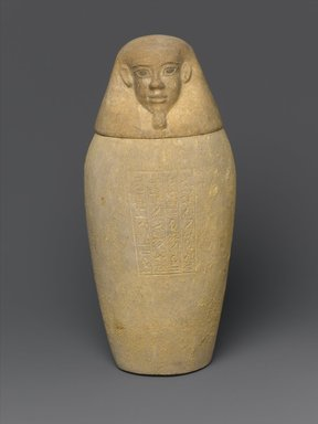 Canopic Jar and Lid (Depicting a Human), 664-525 B.C.E. or later. Limestone, 10 7/16 in. (26.5 cm) high x 4 1.2 in. (11.4 cm) diameter. Brooklyn Museum, Charles Edwin Wilbour Fund, 37.896Ea-b. Creative Commons-BY
