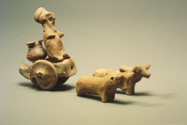 Harappa. Body of a Toy Chariot, 3000-2500 B.C. Reddish pottery, with modern shaft and axle: 3 1/8 x 6 1/8 in. (8 x 15.5 cm). Brooklyn Museum, A. Augustus Healy Fund, 37.92. Creative Commons-BY