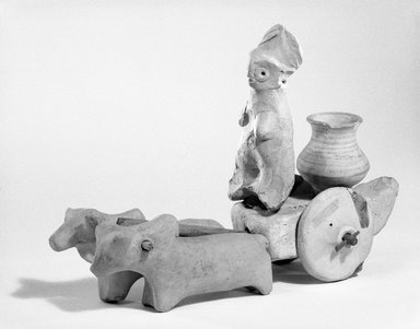 Harappa. Small Solid Wheel for Toy Chariot, ca. 2500 B.C.E. Hand-modeled terra-cotta, 1 3/4 in. (4.5 cm). Brooklyn Museum, A. Augustus Healy Fund, 37.93. Creative Commons-BY