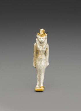 Amulet of a Striding Lion-Headed Goddess. Faience, glazed, 2 3/16 x 9/16 x 9/16 in. (5.5 x 1.5 x 1.5 cm). Brooklyn Museum, Charles Edwin Wilbour Fund, 37.930E. Creative Commons-BY
