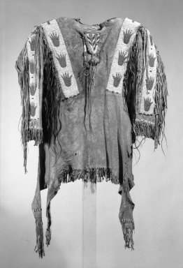 Sioux (Native American). Decorated Shirt, 1801-1900. Buckskin, pigment, beads, hair, fether, fibre, 46 x 67 x 5 in. (116.8 x 170.2 x 12.7 cm). Brooklyn Museum, Dick S. Ramsay Fund, 38.629. Creative Commons-BY