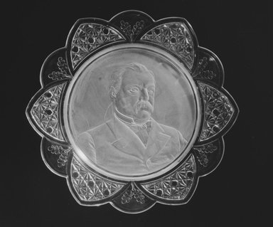 Plate (Grover Cleveland), ca. 1884. Glass, 1 1/8 x 11 1/2 x 11 1/2 in. (2.9 x 29.2 x 29.2 cm). Brooklyn Museum, Gift of Mrs. William Greig Walker by subscription, 40.163. Creative Commons-BY