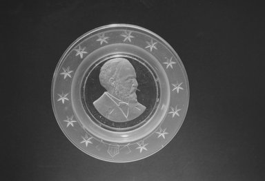 Plate (James Garfield), ca. 1881. Glass, 1 x 6 x 6 in. (2.5 x 15.2 x 15.2 cm). Brooklyn Museum, Gift of Mrs. William Greig Walker by subscription, 40.168. Creative Commons-BY