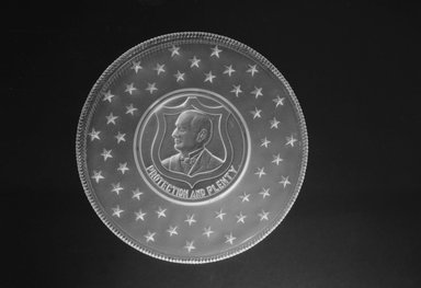 Plate (William McKinley), ca. 1896. Glass, 1 x 7 1/4 x 7 1/4 in. (2.5 x 18.4 x 18.4 cm). Brooklyn Museum, Gift of Mrs. William Greig Walker by subscription, 40.173. Creative Commons-BY