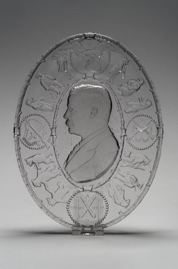American. Plate (Theodore Roosevelt), 1904. Glass, 1 1/8 x 7 7/8 x 10 3/8 in. (2.9 x 20 x 26.4 cm). Brooklyn Museum, Gift of Mrs. William Greig Walker by subscription, 40.177. Creative Commons-BY