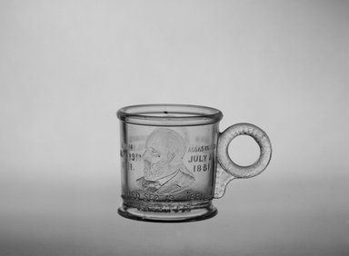 Mug (Abraham Lincoln & James Garfield), ca. 1881. Glass, 2 5/8 x 3 7/8 x 2 5/8 in. (6.7 x 9.8 x 6.7 cm). Brooklyn Museum, Gift of Mrs. William Greig Walker by subscription, 40.182. Creative Commons-BY