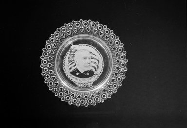 Plate (George Dewey), ca. 1899. Glass, 3/4 x 5 1/2 x 5 1/2 in. (1.9 x 14 x 14 cm). Brooklyn Museum, Gift of Mrs. William Greig Walker by subscription, 40.185. Creative Commons-BY