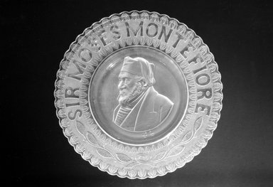 Plate (Sir Moses Montefiore), ca. 1885. Glass, 1 1/4 x 10 1/2 x 10 1/2 in. (3.2 x 26.7 x 26.7 cm). Brooklyn Museum, Gift of Mrs. William Greig Walker by subscription, 40.193. Creative Commons-BY