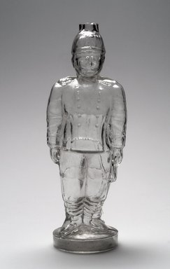 American. Bottle, Figure of Theodore Roosevelt, 1909. Glass, 11 1/8 x 4 x 3 1/4 in. (28.3 x 10.2 x 8.3 cm). Brooklyn Museum, Gift of Mrs. William Greig Walker by subscription, 40.276. Creative Commons-BY
