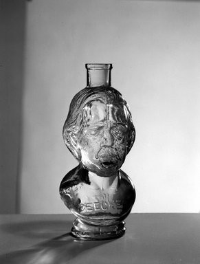 Bottle, Bust of Henry Ward Beecher, 1887. Glass, 6 3/4 x 3 x 3 in. (17.1 x 7.6 x 7.6 cm). Brooklyn Museum, Gift of Mrs. William Greig Walker by subscription, 40.279. Creative Commons-BY