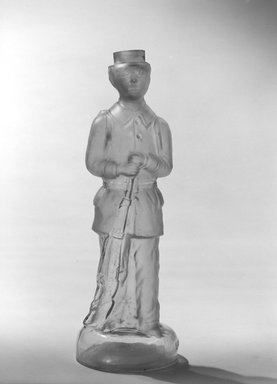 American. Bottle, Figure of French Soldier, late 19th century. Glass, 11 1/2 x 3 3/4 x 3 3/4 in. (29.2 x 9.5 x 9.5 cm). Brooklyn Museum, Gift of Mrs. William Greig Walker by subscription, 40.280. Creative Commons-BY