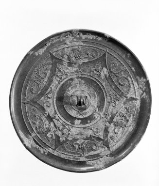 Mirror, 481-221 B.C. Bronze, Diam.: 4 13/16 in. (12.2 cm). Brooklyn Museum, 40.510. Creative Commons-BY