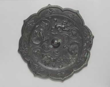 Mirror, 618-906 C.E. Bronze, Diameter: 7 5/8 in. (19.4 cm). Brooklyn Museum, A. Augustus Healy Fund, 40.716. Creative Commons-BY