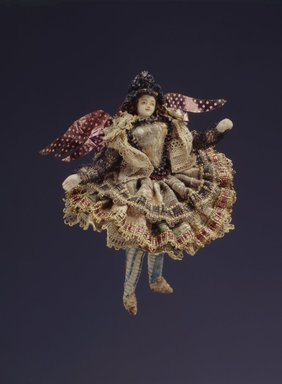 One of a Collection of Briscada Angels and Doll Heads with Wings. Metal; silver tinsel, wire, cloth, hair, shell Brooklyn Museum, Museum Expedition 1941, Frank L. Babbott Fund, 41.1275.250e. Creative Commons-BY