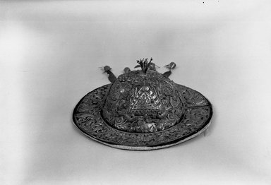 Possibly Aymara. Festival Hat, 18th century. Repoussé silver plaques on velvet, glass beads, wire, 4 15/16 x 13 1/4 x 13 1/4 in. (12.5 x 33.7 x 33.7 cm). Brooklyn Museum, Museum Expedition 1941, Frank L. Babbott Fund, 41.1275.274c. Creative Commons-BY