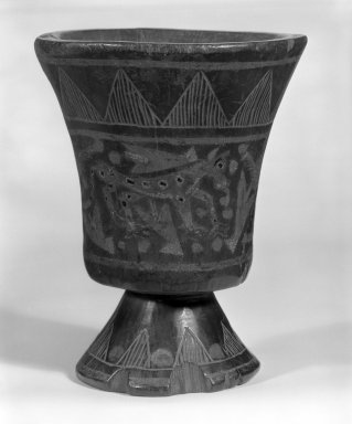 Inca. Kero Cup with a Stemmed Foot. Wooden lacquered, 5 7/8 x 4 3/4 in.  (14.9 x 12.1 cm). Brooklyn Museum, Museum Expedition 1941, Frank L. Babbott Fund, 41.1275.6. Creative Commons-BY
