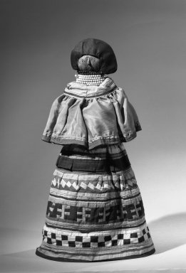 Seminole (Native American). Doll Wearing Complete Typical Costume of a Seminole Woman, ca. 1940. Fiber, cotton, silk, beads, coconut husk, 16 5/16 x 21 1/4 in.  (41.5 x 54.0 cm). Brooklyn Museum, A. Augustus Healy Fund, 41.222. Creative Commons-BY
