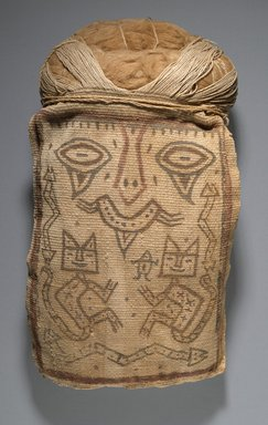 Paracas Ocucaje. False Head for Burial Bundle or Mummy Mask, 200-100 B.C.E. Cotton, pigments, 13 1/2 x 7 1/4 x 3 in. (34.3 x 18.4 x 7.6 cm). Brooklyn Museum, Henry L. Batterman Fund, 41.428. Creative Commons-BY