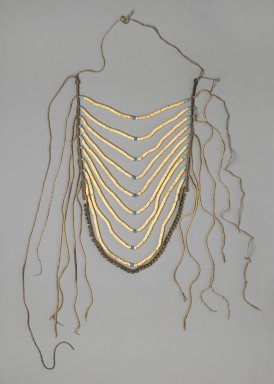 Crow (Native American). Man's Breastplate, 1880-1900. Shell, glass beads, commercial leather, brass, twine, 18 1/2 x 11 7/16 in. (47 x 29.1 cm). Brooklyn Museum, By exchange, 41.863. Creative Commons-BY