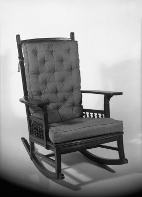 American. Rocking Chair, ca. 1881. Mahogany with upholstered pads for back and seat, 37 11/16 x 28 1/2 x 34 in. (95.8 x 72.4 x 86.3 cm). Brooklyn Museum, Gift of Mrs. William E. S. Griswold in memory of her father, John Sloane, 41.980.9. Creative Commons-BY