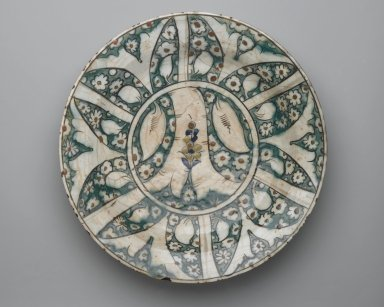 Plate, early 17th century. Ceramic, Kubachi ware; fritware, painted in black, blue and green with brown and yellow slips under a transparent glaze, 13 3/4 x 2 5/8 in. (35 x 6.6 cm). Brooklyn Museum, Gift of Mrs. Horace O. Havemeyer, 42.212.38. Creative Commons-BY