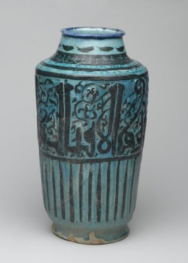 Albarello, 13th century. Ceramic; fritware, molded and painted in black and cobalt blue (rim) under a transparent turquoise glaze, 12 11/16 x 6 5/16 in. (32.3 x 16 cm). Brooklyn Museum, Gift of Mrs. Horace O. Havemeyer, 42.212.41. Creative Commons-BY
